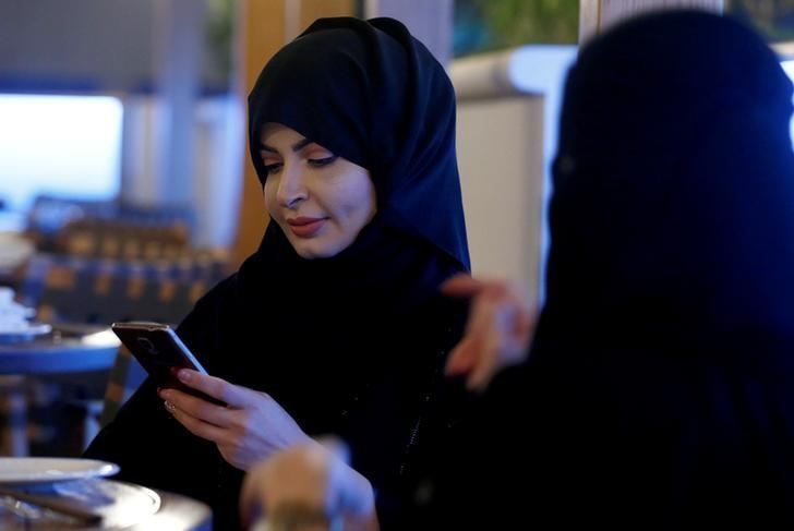 REPRESENTATIVE IMAGE: A woman uses her mobile phone in a cafe in Riyadh, Saudi Arabia October 6, 2016. Picture taken October 6, 2016. REUTERS/Faisal Al Nasser/File photo