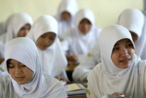 Muslim student girls attend a class meeting at the Darul Muttaqien Islamic boarding school in Bogor, Indonesia. Photo: Reuters
