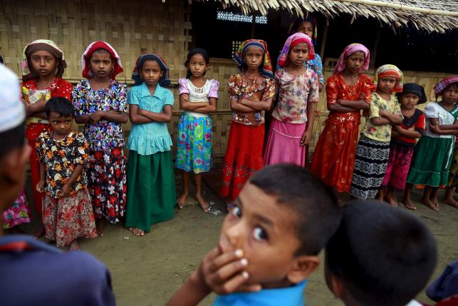 Children attend a class on the Koran conducted by a Rohingya Muslim religious teacher at a refugee camp outside Sittwe, Myanmar. REUTERS/SOE ZEYA TUN