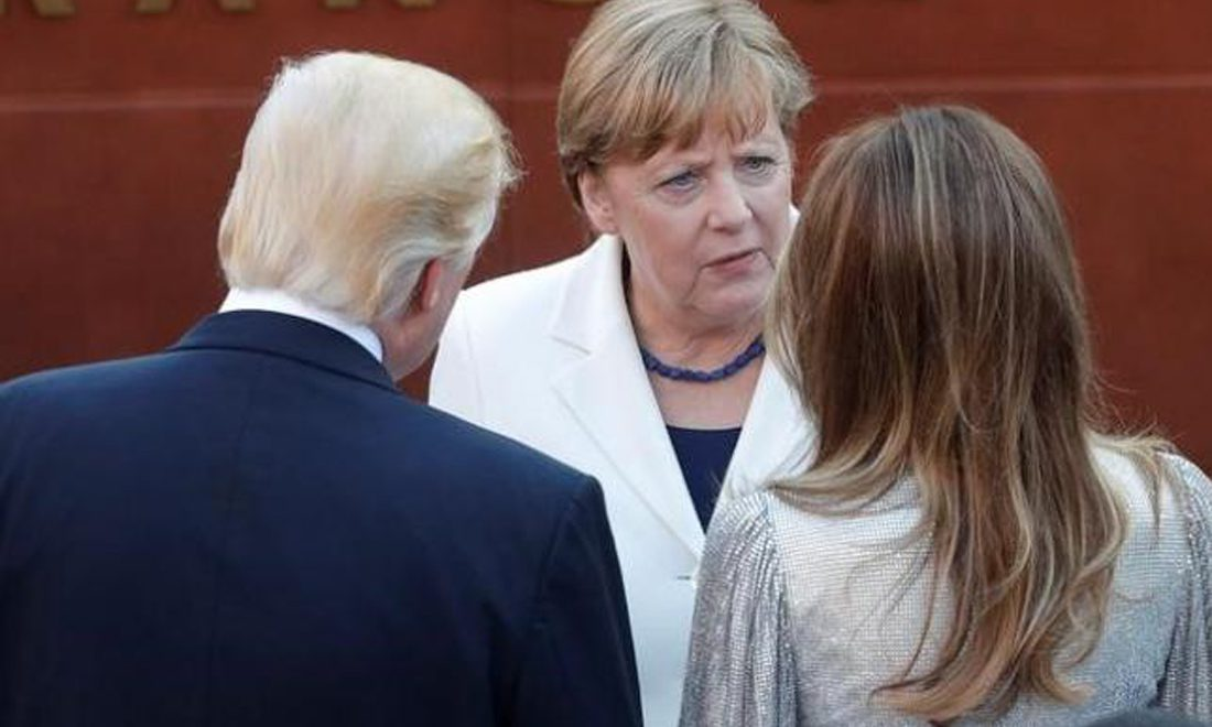 German Chancellor Angela Merkel talks to Donald and Melania Trump at the G7 Summit in Sicily, May 26, 2017. REUTERS/Philippe Wojazer